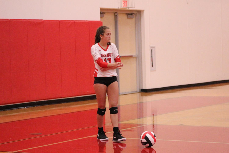 Alyssa+Richardson%2C+grade+11%2C+prepares+to+serve+the+ball+in+girls+varsity+volleyball+game.+