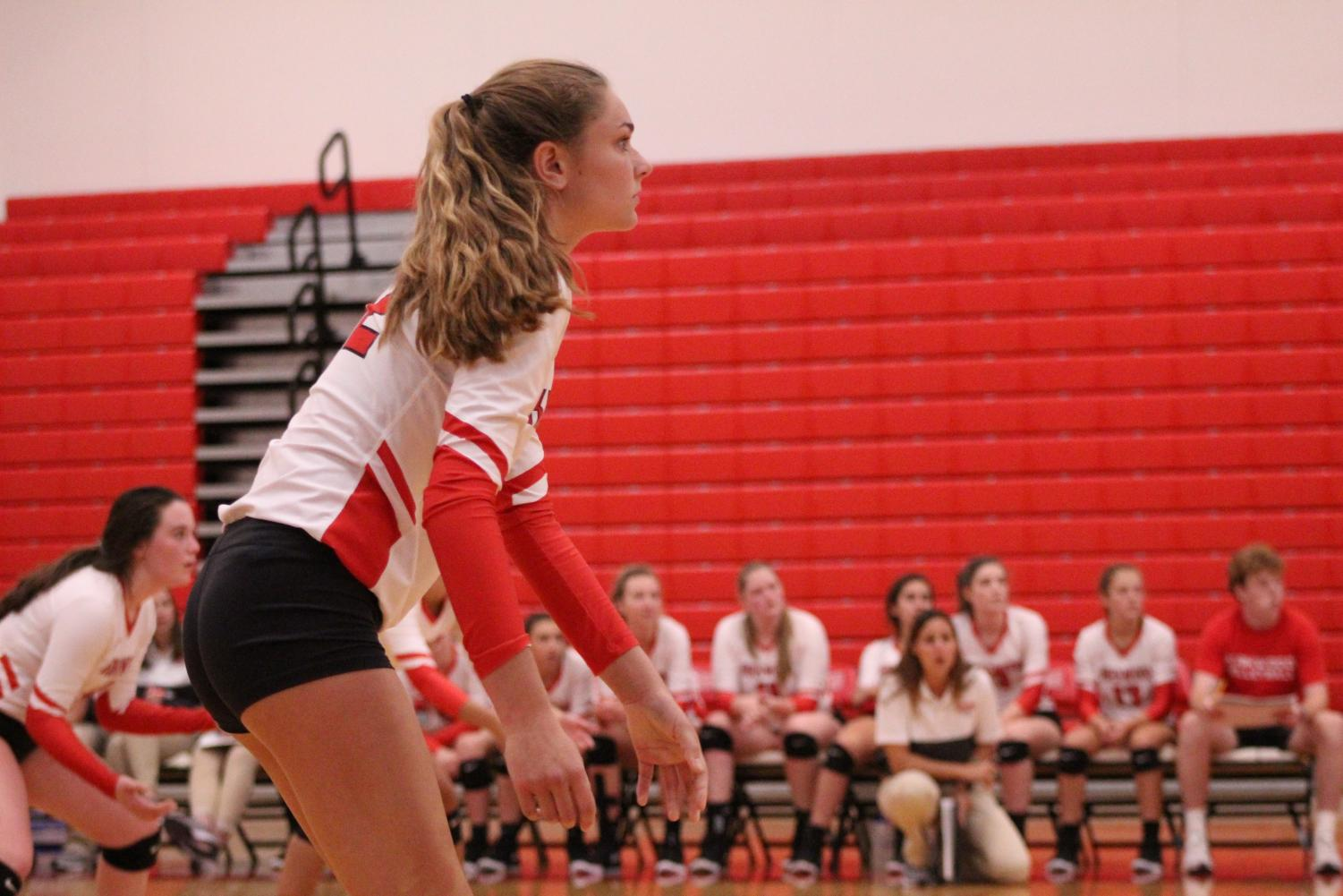 Amanda+Mobley%2C+grade+11%2C+waits+for+Ursuline+to+the+serve+the+ball%2C+in+varsity+game.+