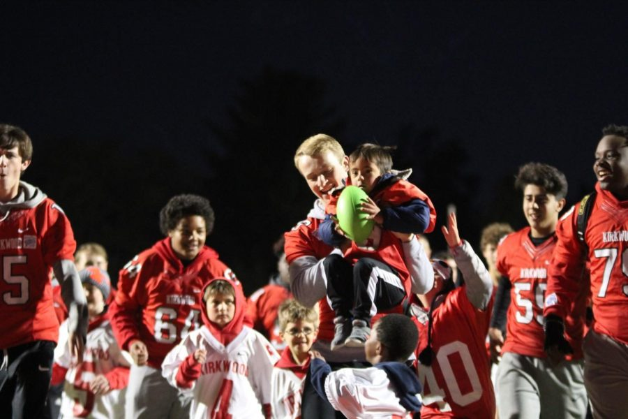 Brady Nauman, sophomore, holds Myles Young after he scored a touchdown.
