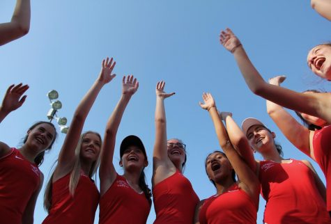 The KHS girls JV tennis team says their cheer before their match.