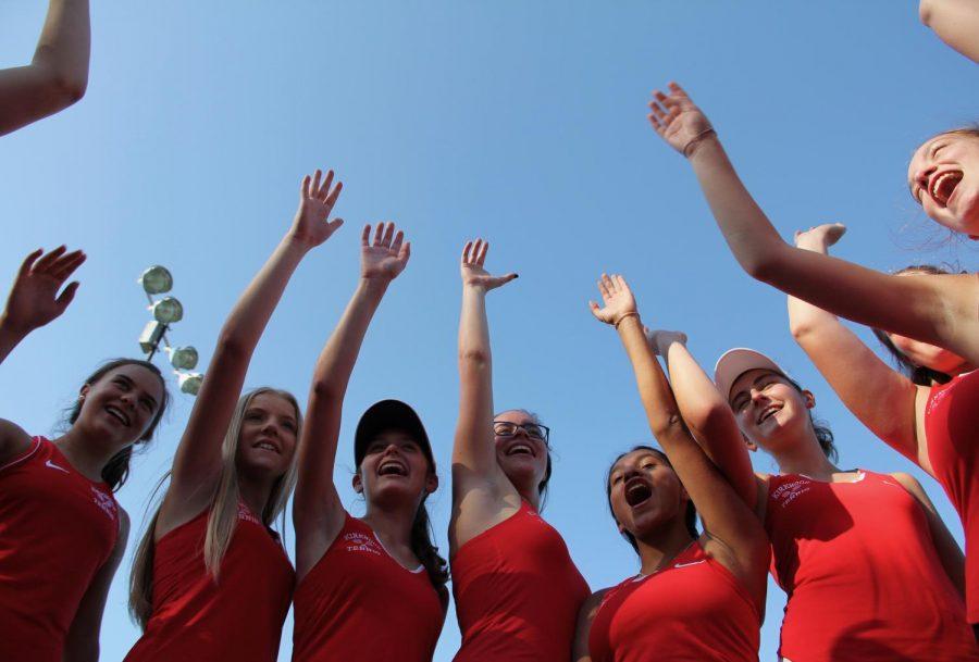 The KHS girls JV tennis team says their cheer before their match.