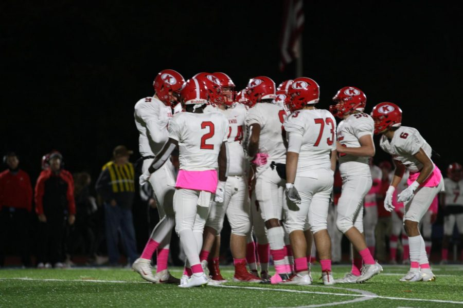 Kirkwood's offense meets in a huddle before the play.