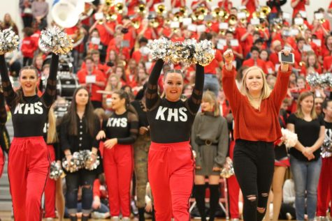 Abbey Siegel, senior, leads the pommies during their dance at the pep rally.