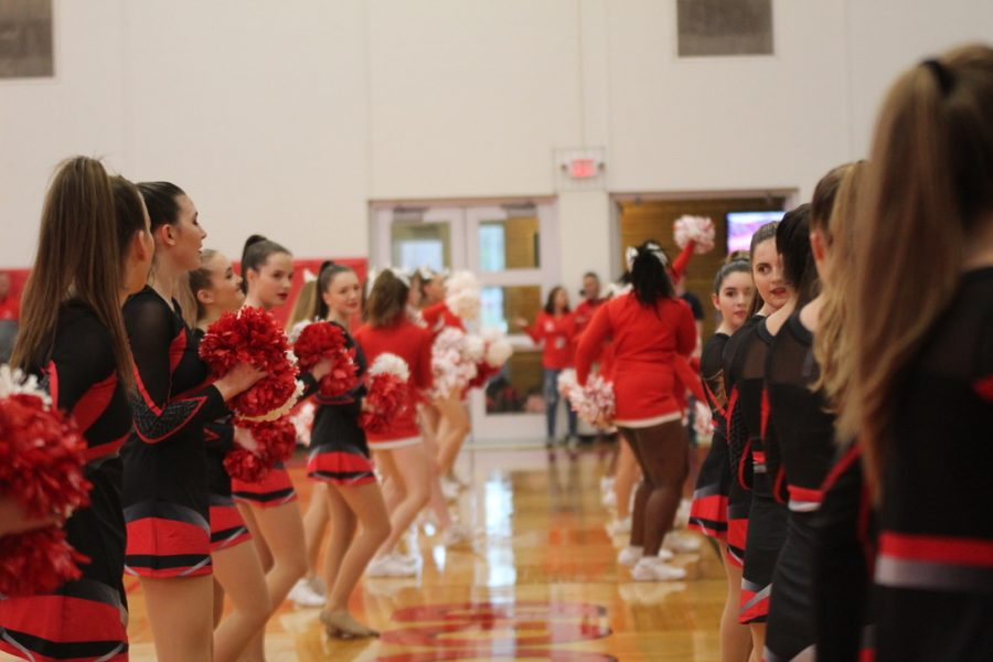 The+pommies+and+cheerleaders+perform+on+the+sidelines+before+the+pep+rally+starts.+