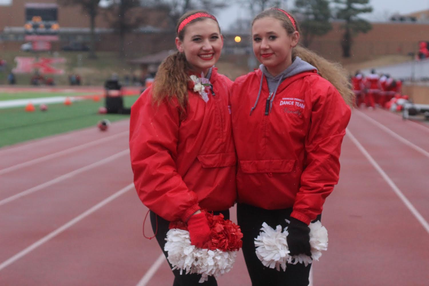 Isabella Knopfel, sophomore, and Olivia Knopfel, senior, pose after the Turkey Day game.