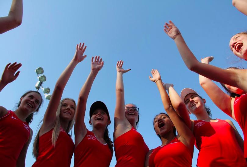 The KHS JV girls' tennis team says their cheer before their match.