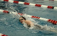 Elizabeth Green, sophomore, turns for a breath during her 200 freestyle.