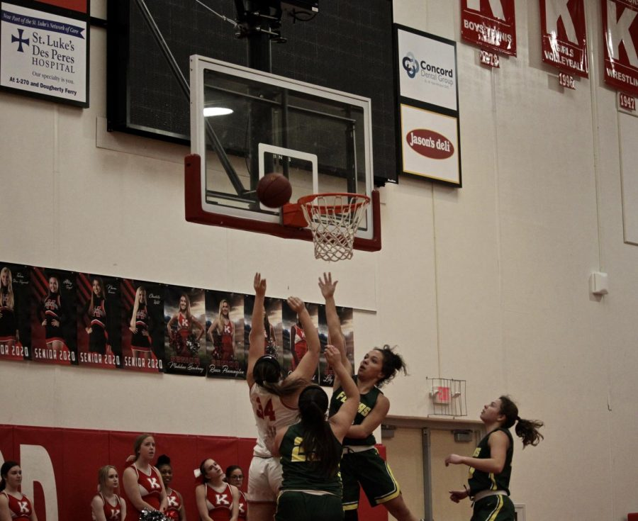 Eliana+Poger%2C+sophomore%2C+jumps+to+receive+ball.+