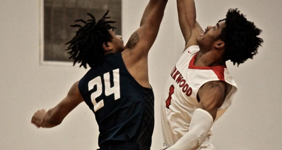 Will Lee, junior, attempts to reach pass his opponent during a jump ball.