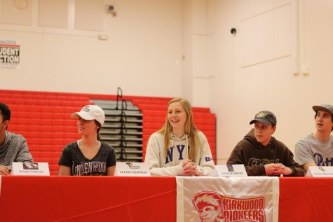 Natalie Bruns, senior, smiles as she is introduced during the ceremony. Bruns  is committed to play basketball at New York University in the fall.