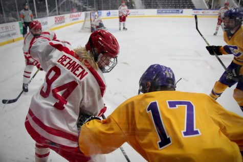 Devin Behnem, junior, fights for the puck from a CBC player.