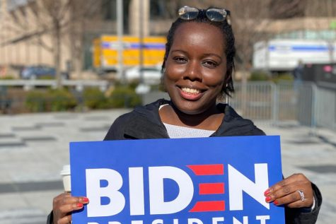 Tiffany Hamilton holds her Biden sign at his rally in downtown STL.