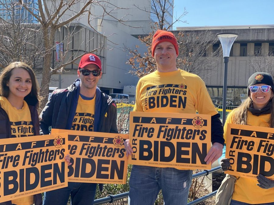 Biden supporters gather in line with Fire Fighters for Biden signs.