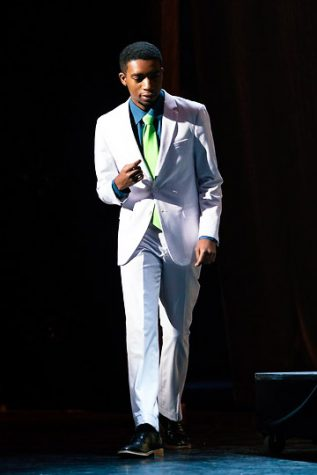 Emmanuel Morgan snaps along to the rhythm of the song. Photo courtesy of Emmanuel Morgan.