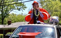 Aaron Stiegletz, senior, smiles at camera from sunroof.