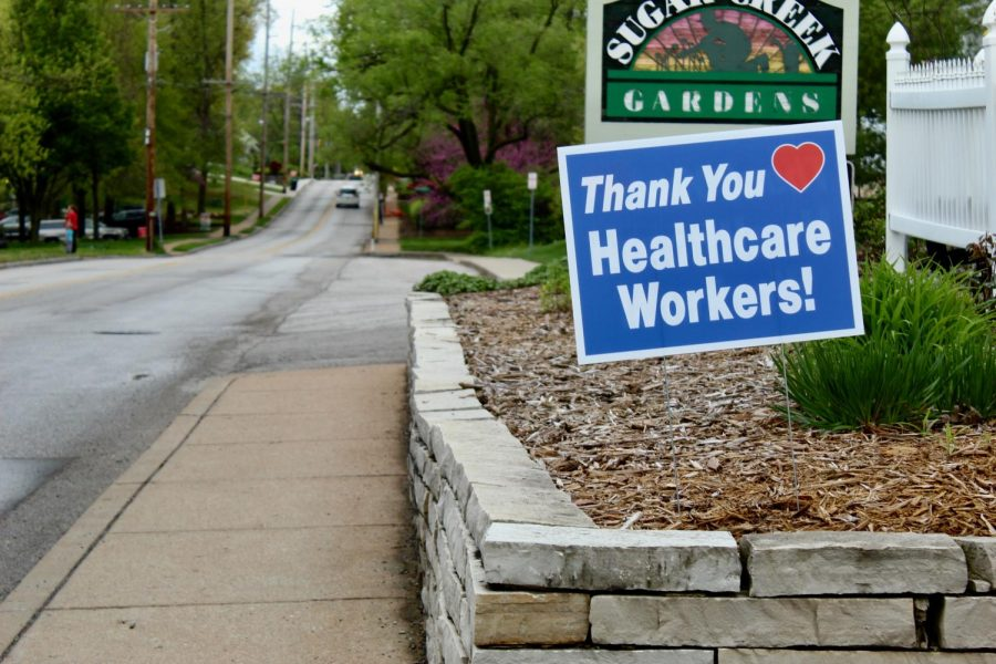 Many local businesses and homes are displaying signs to show their support for workers on the front lines of the pandemic.
