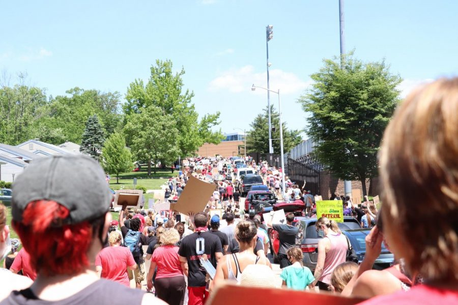 Protestors walk up Chopin street during the June 6 peace walk.