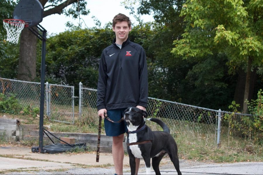 Rj Morgan, junior, and his dog Hank.