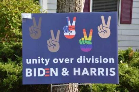 A Biden sign in a yard emphasizes the importance of unity.