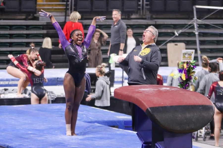 After sticking her vault, Kiya Johnson and her coach, Bob Moore, celebrate her first perfect 10 on vault at the Gymquarters Invitational, Feb. 14th.