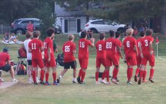 The Kirkwood bench celebrates as their team scores a penalty kick.
