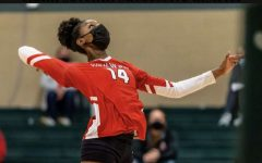 Laila Person, freshman, prepares to hit the ball at the varsity volleyball district championship against Cor Jesu. Photo courtesy of St. Louis Post Dispatch.