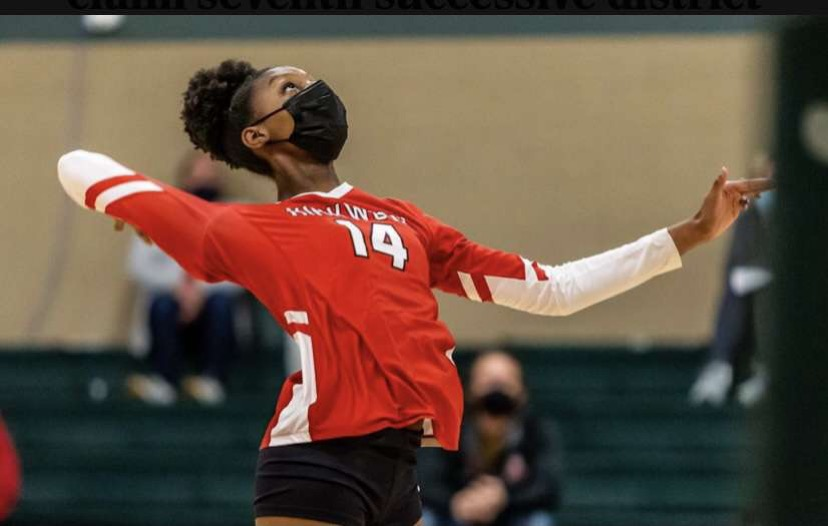 Laila+Person%2C+freshman%2C+prepares+to+hit+the+ball+at+the+varsity+volleyball+district+championship+against+Cor+Jesu.+Photo+courtesy+of+St.+Louis+Post+Dispatch.