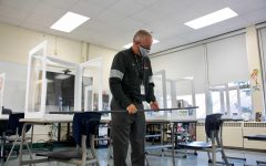 Dr. Michael Havener follows contract tracing procedures by measuring 6 feet between desks after a positive test.