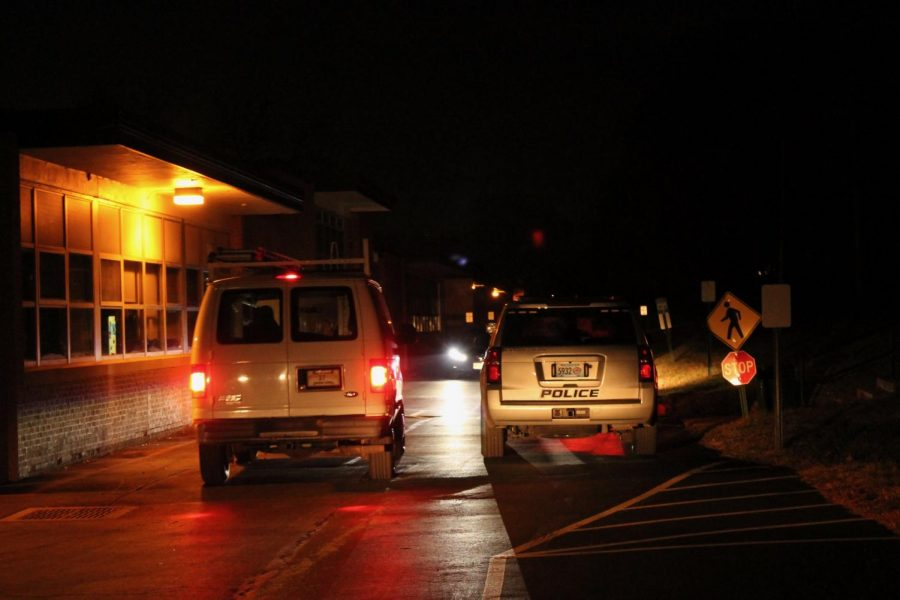 Police and maintenance surround the crime scene on Wednesday, Jan. 6.