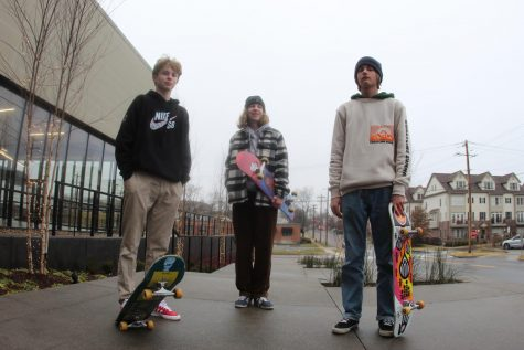 Ryder George-Lander (Left), Devon Bennett (Center) and Camden Davis (Right) standing together with their skateboards.