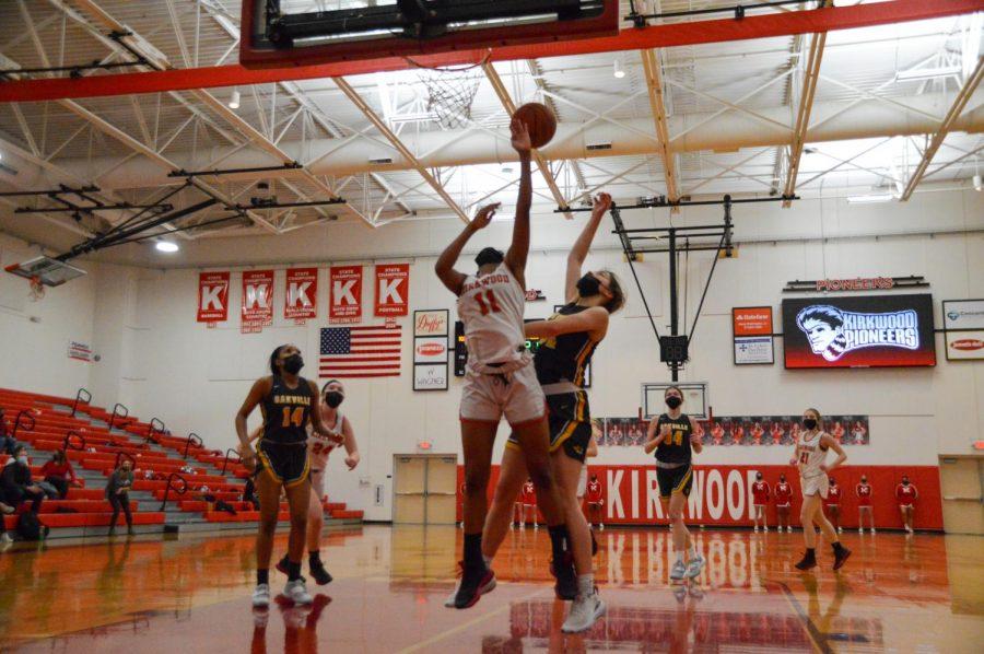 Khamori Cornelius takes a shot in the girls varsity basketball game against  Oakville.