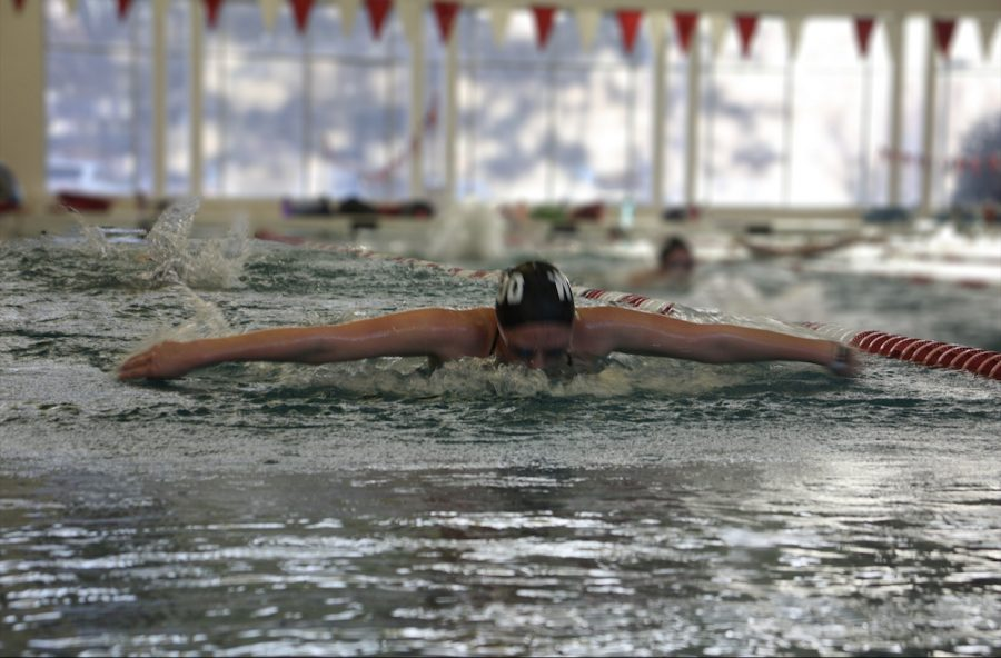 Emma Pearl, the 2020 Missouri Girls Swimmer of the Year, swims butterfly in a practice.