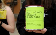 The Haiti fundraiser is collected through metal tins every morning and afternoon.