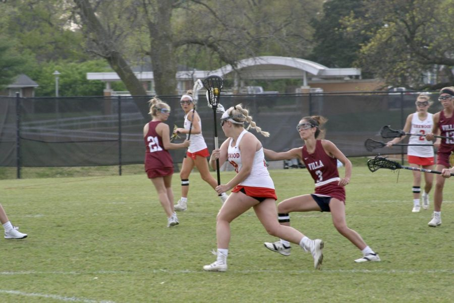 Sydney Shields, sophomore, cradles the ball down to the goal.