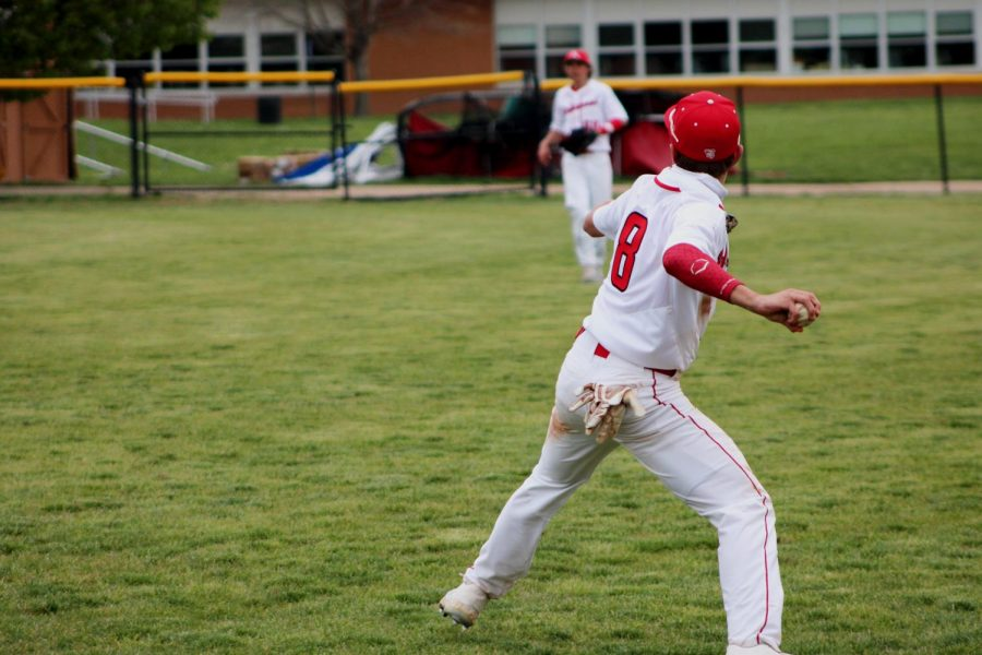 A Kirkwood outfielder tosses the ball to a baseman.