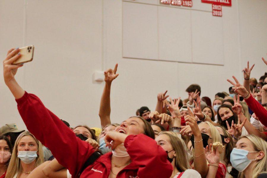 Ellie Buchanan, senior, holds her phone up for a class selfie.