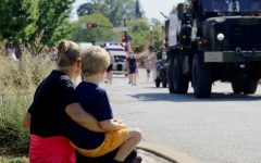 A young boy and his mom watch the parade as it comes down Argonne.