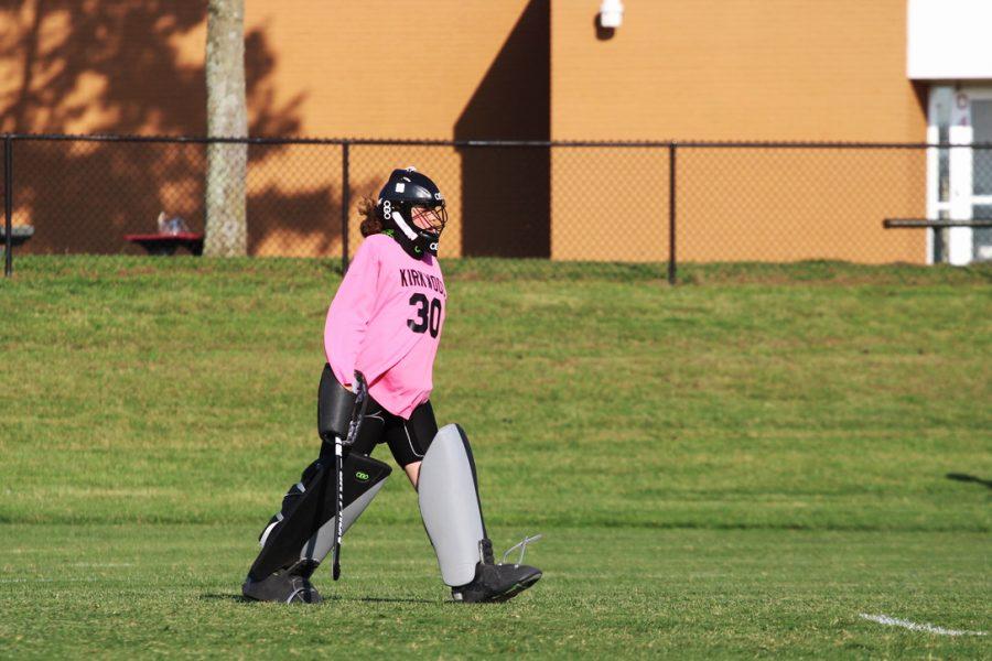 Ellie Hubbard, sophomore varsity goalie, heads to the goal to set up.